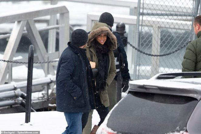 A smiling Meghan was seen for the first time since leaving the country today boarding a sea plane in Vancouver Island, Canada