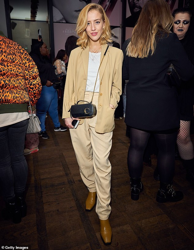 Chic: Sarah Mikaela looked effortlessly cool in a beige trouser suit and camel coloured boots