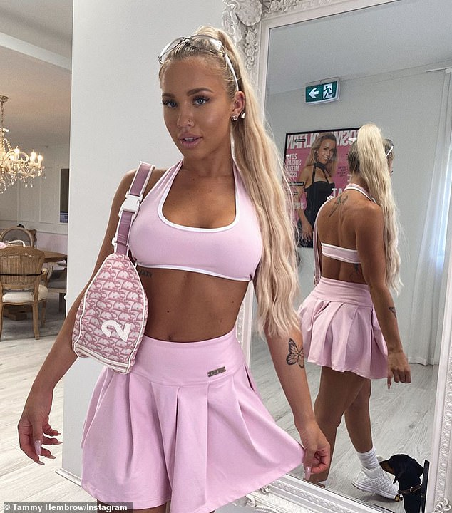 Perky in pink! Tammy Hembrow, 25, flaunted her washboard abs and muscular back in a tiny tennis outfit from her activewear brand Saski Collection on Wednesday