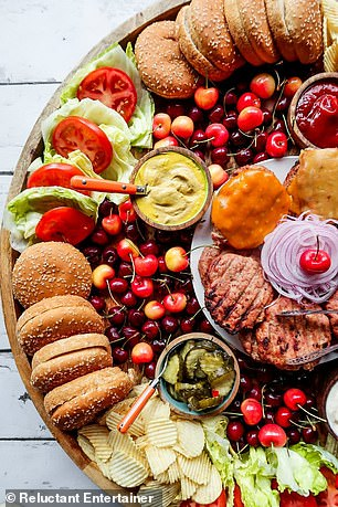 The burger boards are laden with stacks of crusty buns and sliced vegetables like beef tomatoes, iceberg lettuce and red onion