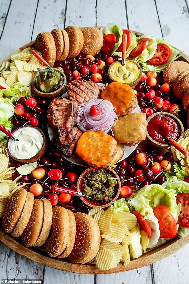 Pots of sauces, including mayonnaise, mustard, ketchup and relish, are dotted around the board, alongside pickle slices for added flavour