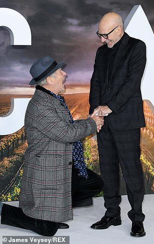Delighted: Sir Ian made an animated display while also kneeling in front of Sir Patrick, before they held hands and talked.