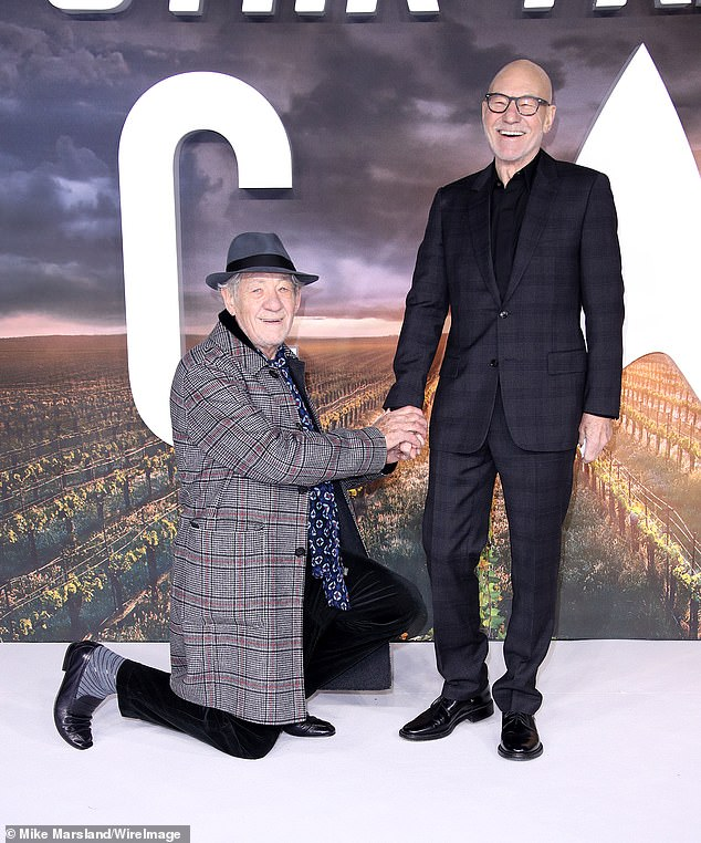 Funny: Sir Patrick laughed after Sir Ian knelt