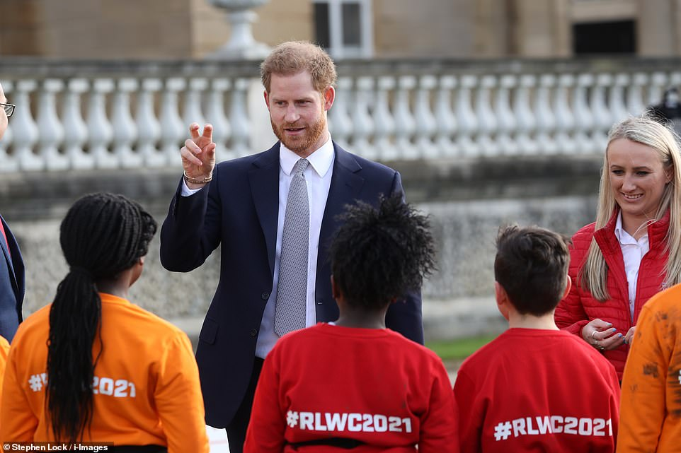 The Duke of Sussex spoke to youngsters given the rare chance of playing rugby league on Her Majesty's lawn