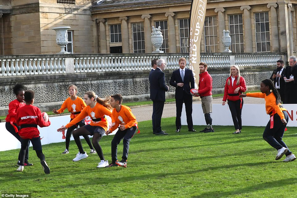 The children - who are tag rugby champions - showed their skills to the impressed prince and dignitaries