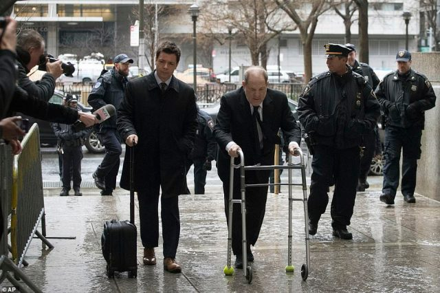 Harvey Weinstein uses a walker as he arrives at a Manhattan courthouse to attend jury selection in his trial on Thursday