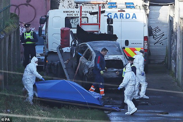A burnt out car which contained human remains, believed to be linked to the disappearance of a 17-year-old boy from Co Louth, is removed from the scene on Trinity Terrace in the Drumcondra area of Dublin on Wednesday