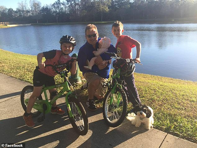 Anthony Todt with his three children and their dog. Police found the bodies in the family home on Monday but were unable to definitively identify them until Wednesday