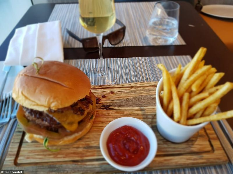 American's Flagship First Dining serves up a superb burger (pictured) and fine Champagne - by Krug