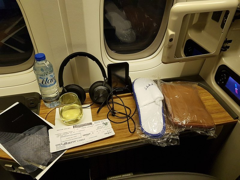 The pre-take-off scene at Heathrow - with Ted's menus, Prosecco, headphones, slippers and amenity kit laid out
