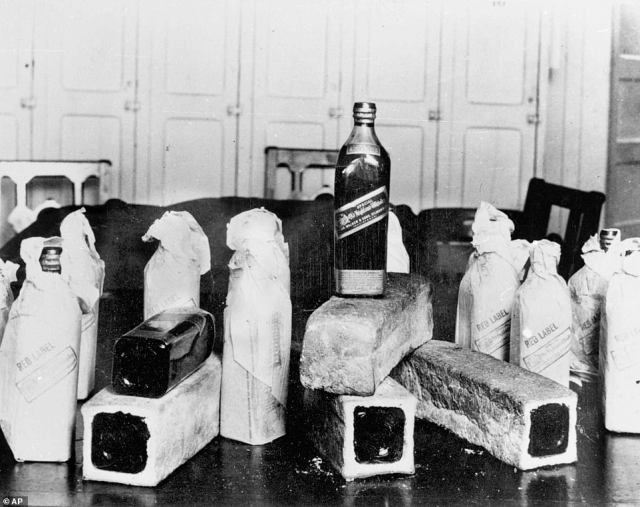 Bottles of Scotch whiskey smuggled in hollowed-out loaves of bread are pictured above in 1924. Statistics show that alcohol-related deaths from cirrhosis declined during Prohibition, as well as public inebriation arrests, but very few statistics measure the extensive and creative means bootleggers used to evade the law.