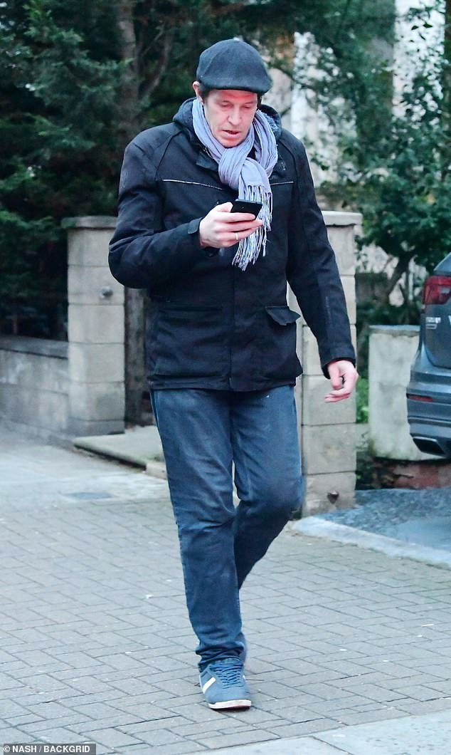 Outing:Christopher seemed mostly preoccupied by his phone as he was spotted on a rare appearance in the capital