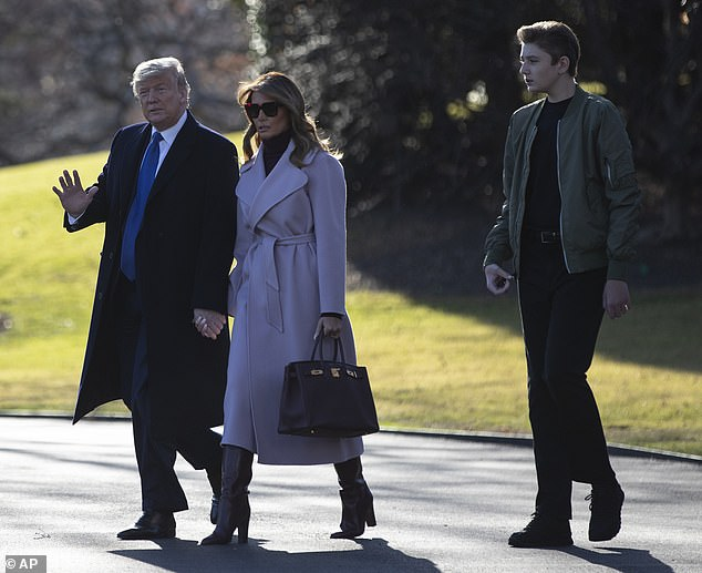 Growing boy: Barron towers over his parents, and he seems to be taking after his half-brother Eric Trump, who is also taller than their father at 6 feet, 4 inches