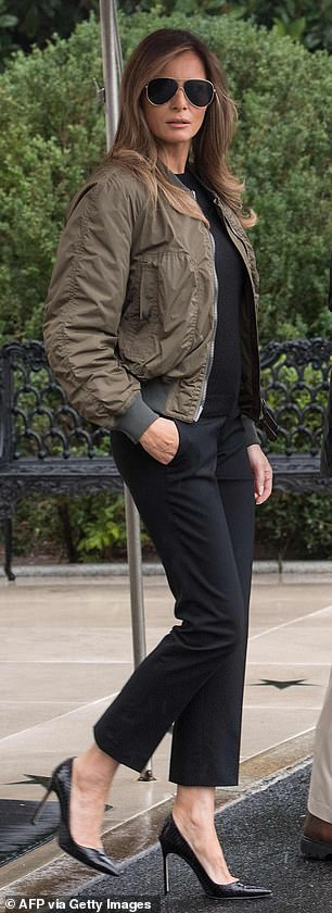 Lookalikes: Barron wore a $150 green flight jacket from Alpha Industries over a black top and pants. His mom donned a nearly identical outfit when she visited Texas in 2017 (pictured)