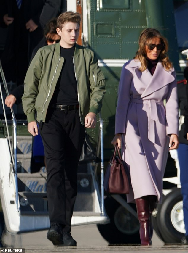 Next stop: Barron appears to have waited for his mother before following his dad