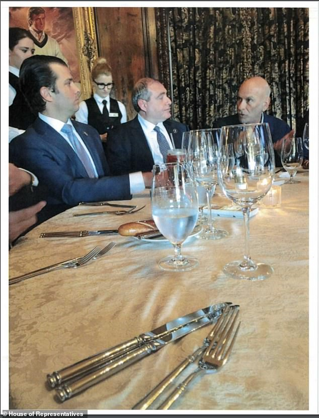 Parnas sits next to Donald Trump Jr in one of the photos released on Friday