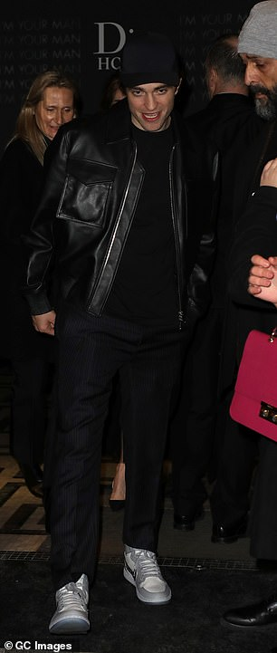Relaxed: The Twilight star donned aclassic black leather jacket over a matching ensemble