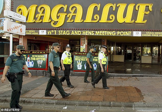 The regional government brought in the measure to halt the 'cheapening' of the Balearic islands and attract investment previously dissuaded by 'uncivic behaviour'. (British police with the Spanish civil guard in Magaluf, in 2015)