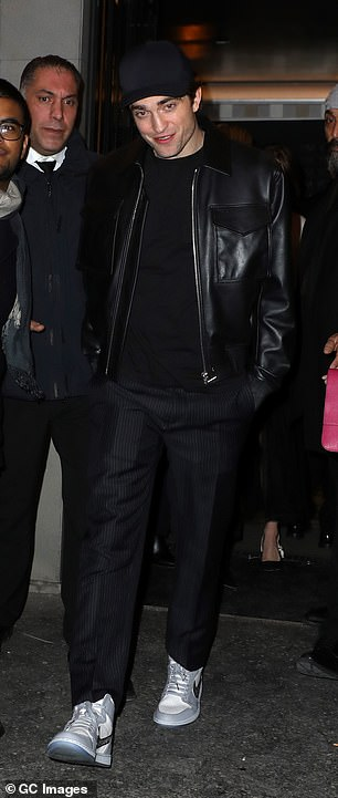 Suave: Suki's boyfriend Robert Pattinson also made a solo exit from the after party