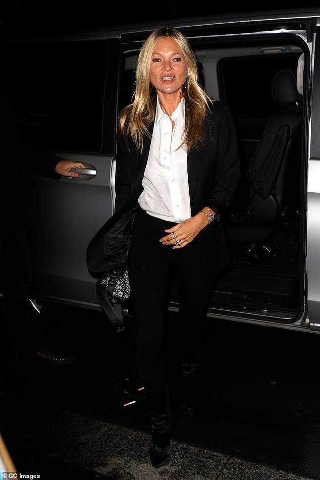 Sharp: Kate Moss, 46, was suited and booted in the same black trouser co-ords and crisp white shirt she sported earlier in the evening to attend the fashion show