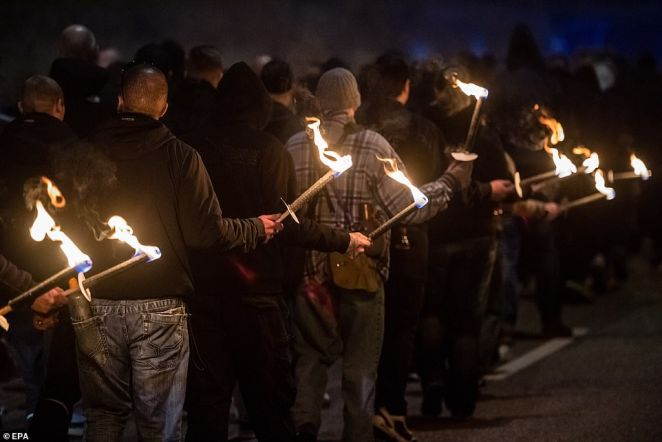 Far right protesters lit torches as they marched through the streets of Magdeburg, in Germany, to mark 75 years since the raid