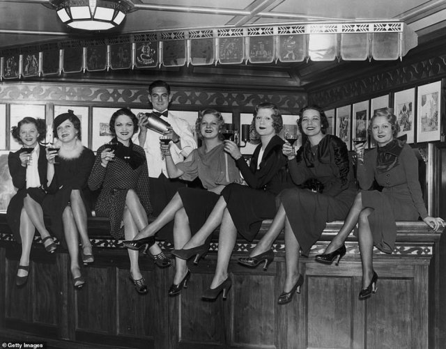 A group of young women sit on the bar on board the luxury liner SS Manhattan, off New York, on December 5, 1933. Before the 21st Amendment was passed, the ship's bar was required to close 12 miles out to sea in international waters.