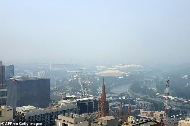 Smoke from bushfires in Victoria fills the sky over Melbourne city on Tuesday