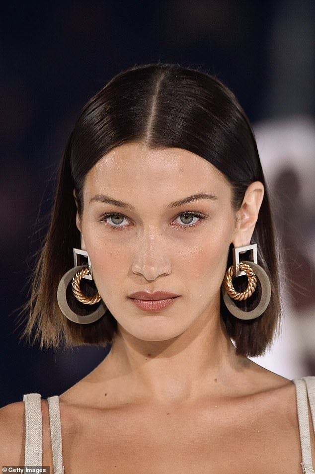 Stunning:Bella's brunette tresses were styled into a sleek centre-parting, while her striking features were accentuated with a subtle palette of make-up