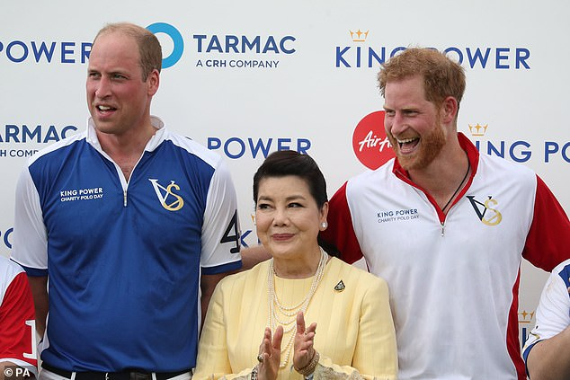 Support: The Duke of Cambridge (left) and the Duke of Sussex (right) withAimon Srivaddhanaprabha, in July 2019 with the wife of late Leicester City ownerVichai Srivaddhanaprabha, who died in a helicopter crash - but despite the smiles the brother reportedly had a row before the event. Yet they have now made up