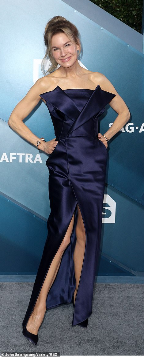 Renee Zellweger chose a shiny strapless gown with pointed heels