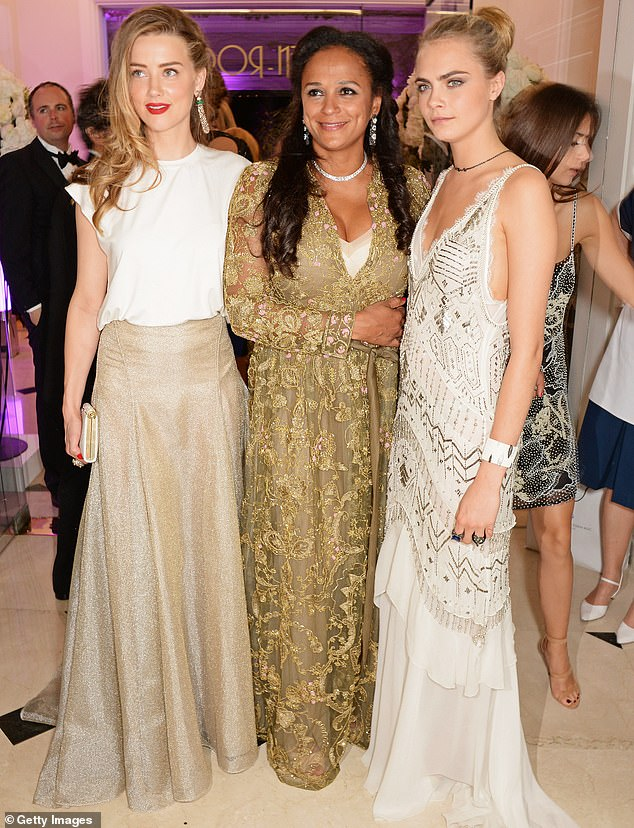 Mrs dos Santos with Amber Heard (left) and Cara Delevingne (right) in Cannes in May 2014