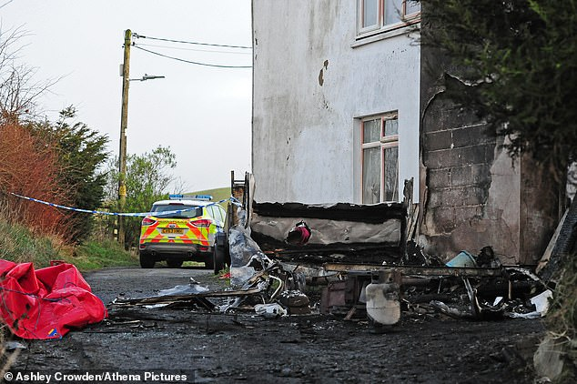 Pictured: The scene after the blaze engulfed a caravan, killing the three-year-old and leaving a four-year-old fighting for his life