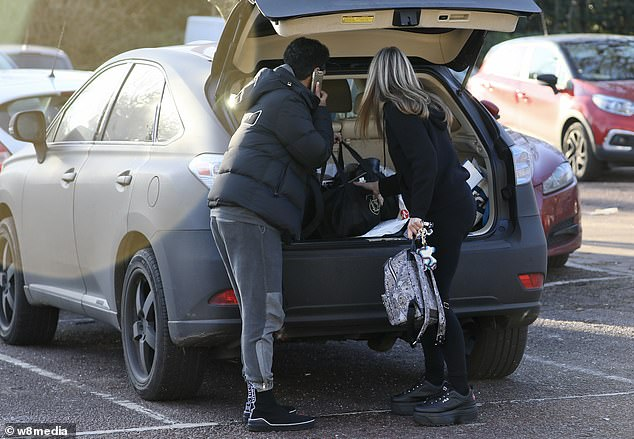 Helping out: They unloaded their things from the boot of the car