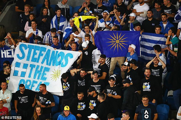 Fans on the stands hold flags and placards during the match between Greece's Stefanos Tsitsipas against Italy's Salvatore Caruso