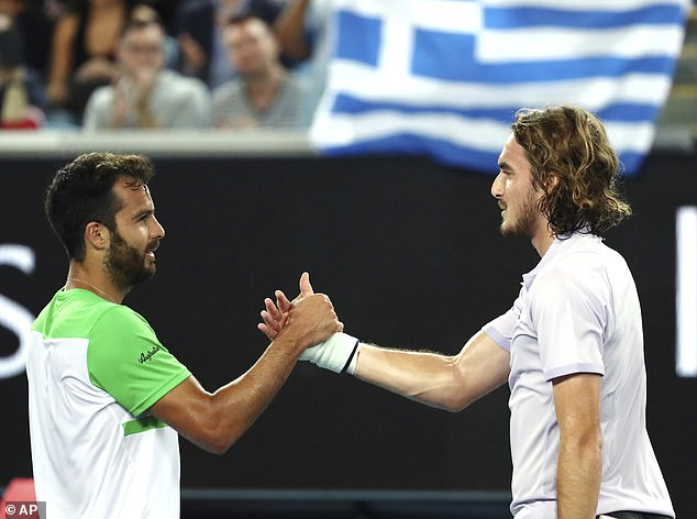 Stefanos Tsitsipas of Greece, right, is congratulated by Italy's Salvatore Caruso after winning