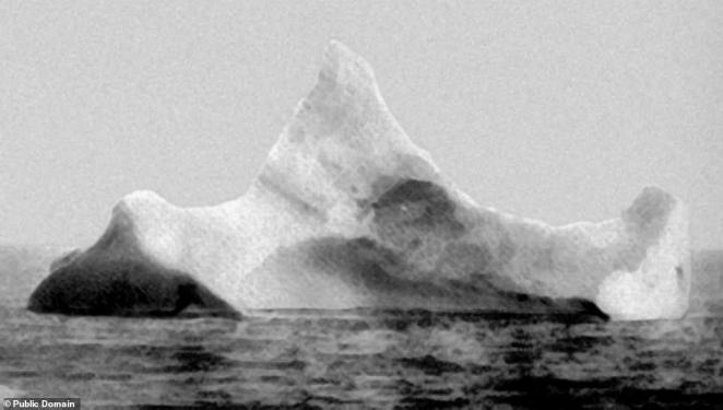 Nearly five days into her voyage, the Titanic struck an iceberg at around 23:40 local time, generating six narrow openings in the vessel's starboard hull, believed to have occurred as a result of the rivets in the hull snapping. Pictured, the iceberg believed to have sunk the Titanic