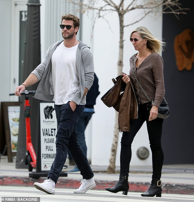 Bonding: Liam Hemsworth (pictured) kept a low profile in sunglasses while spending time his mother Leonie in Los Angeles