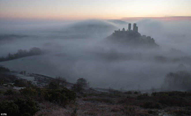 Sunrise over Corfe Castle in Dorset this morning, where overnight temperatures again dipped below freezing