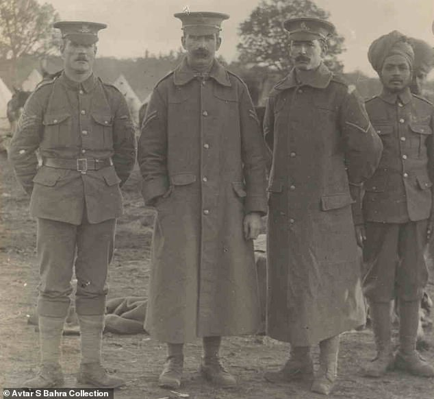 A Sikh soldier lines up with three British comrades on the Western Front during the war in 1917