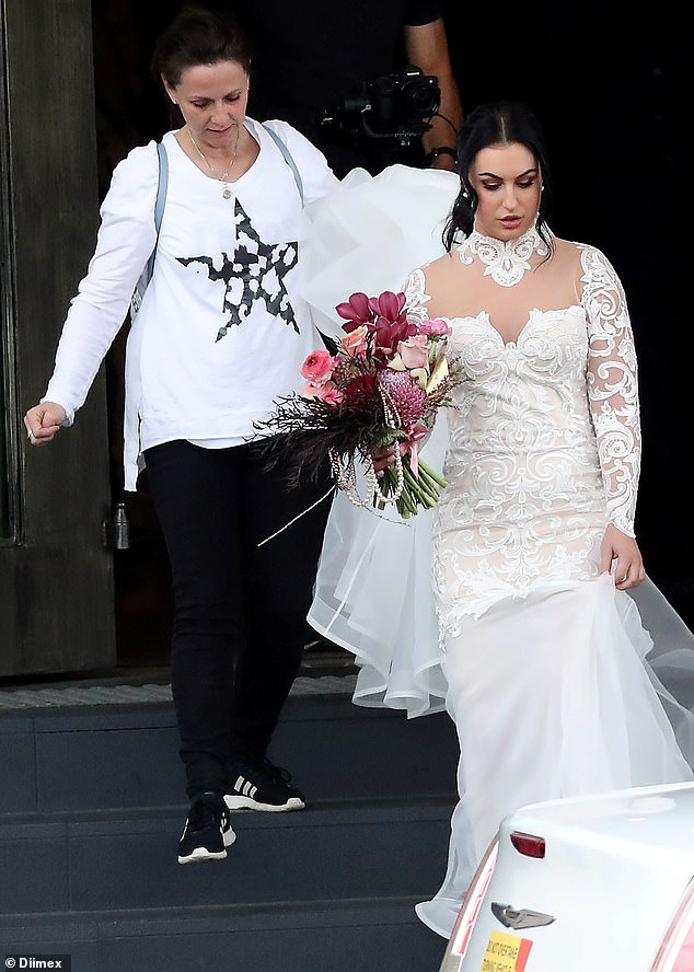 Filming: Daily Mail Australia can offer an exclusive look at the wedding of one of the new MAFS couples, Aleksandra Markovic and Ivan Sarakula. Pictured: Aleksandra and a female producer