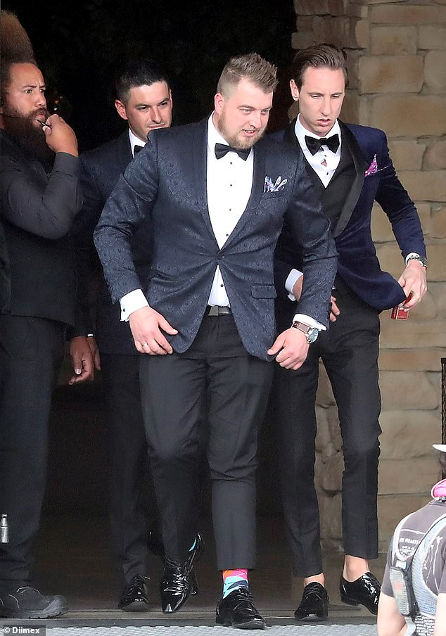 Is everything okay? The sockless groom was seen chatting to his groomsmen and appeared to have worry etched on his face