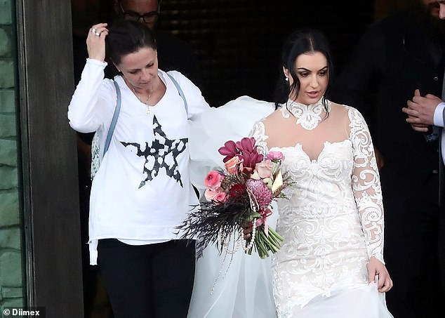 We've seen her before! Aleksandra, 31, who previously appeared on Take Me Out in 2018, wore a white lace wedding dress while walking out of the church