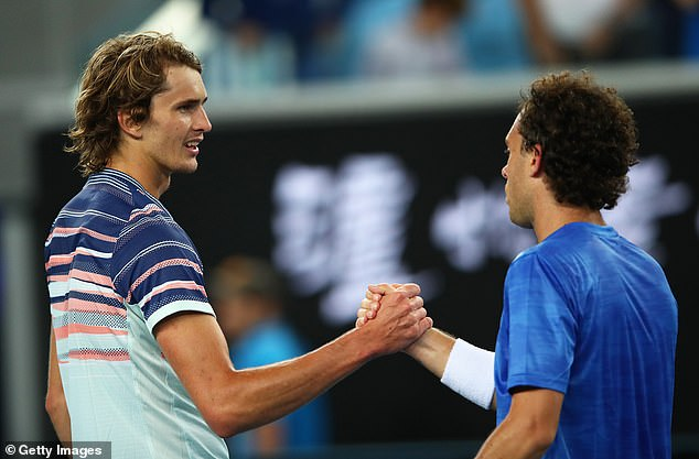 Alexander Zverev of Germany shakes hands at the net after his straight sets victory in his Men's Singles first round match against Marco Cecchinato of Italy