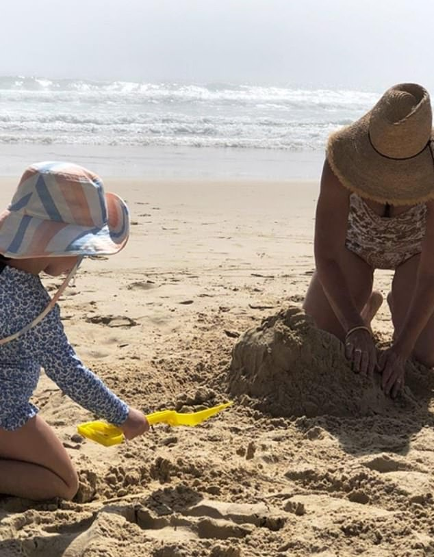 Family fun! She also took to Instagram to share some precious family snaps including a picture of her mum Sarah (right) and Poppy building sandcastles