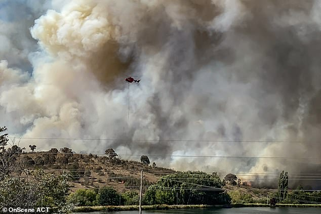 An out-of-control bushfire is hurtling towards homes in the outskirts of Canberra with residents warned their lives are at risk