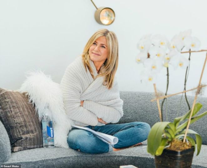 Lovely:The Smart Water campaign also had Jennifer seated on her large gray couch with her gold hardware accents in her living room
