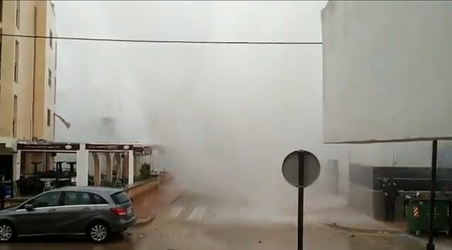 Footage taken from within an entrance to a building showed an apocalyptic wall of water heading straight towards apartments