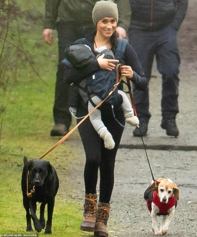 Meghan took her eight-month-old son Archie and her two dogsOz and Guy for a walk on Vancouver Island on Monday