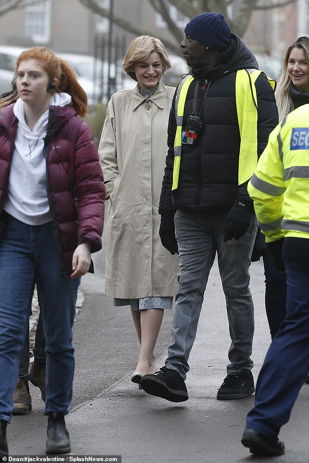 Star: Emma joked with members of the security team and was joined by a runner and her makeup artist during the walk from her trailer to the cathedral