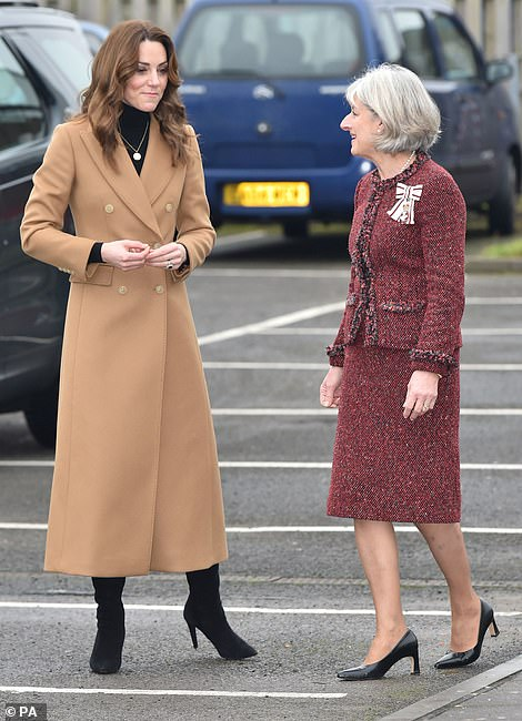 Kate smiles as she arrives for her first visit today
